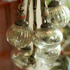Rustic baubles made from recycled glass look lovely hung together in a window, as table decorations or on your tree.
