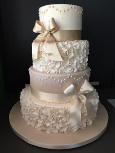 Ruffled and hand piped 4 tier in latte and Ivory! So beautiful.