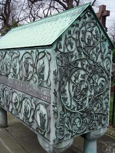 A wonderful Art Noveau style copper monument from Brompton Cemetery London.