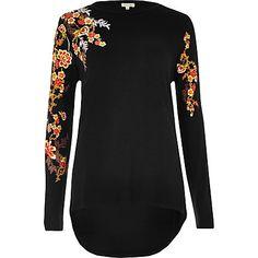 Black floral puff print top $48.00
