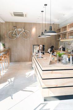 Could highlight bikes in class or on walk hangers Restaurant Interior Design, Shop Interior Design, Cafe Design, Coffee Bar Design, Cafe Counter, Small Coffee Shop, Café Bar, Lokal, Coffee Cafe