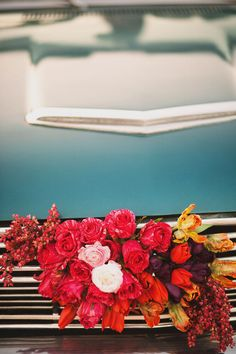 white and pink flowers for the front of the wedding day car!
