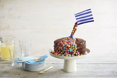 For the ultimate showstopping bake, it has to be a gravity-defying cake, with sweets pouring over the top and tumbling down the sides. This bake definitely has the wow factor and is perfect for impressing guests at a birthday party or celebration. It's easy to create your own version with our simple step-by-step guide. Once you have mastered the technique, use your imagination and create different variations of this dazzling cake.