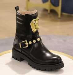 Whether it's rain or shine, our #MiniHarrods members are always ready to step out in style... #Versace