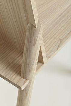 Santi  Guerrero  Font  Numbers Chair  This chair is visually very simple and honest; one can see where the legs pass through the structure, and where their ends become flush with the seat. The final piece it is composed by simple structural joint that hides the complexity of an accurate jig.