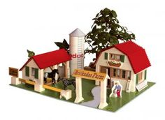Construction kit with real bricks of a farm. The building blocks can be reused because the cement is dissolved in water. Contains: construction bricks, cement , wood building components, spatula, bowl, plate and a foam board with figures.