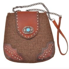 The SHANIA leather crossbody - BROWN HP 6/20Hello to all my southern belles or gal who loves some fun western gear. STUDDED CROSSBODY BAG WITH TURQUOISE FILIGREE. The flap & handles are 100% leather. Such a beautiful crossbody. Very limited quantities available. ‼️NO TRADE, PRICE FIRM‼️ Bags Crossbody Bags