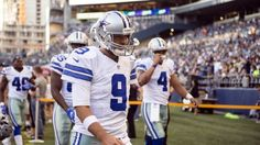 Dallas Cowboys quarterback Tony Romo (9) walks off the field after warming up before the start of a preseason game against the Seattle Seahawks at CenturyLink Field.