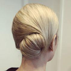 Rock a low, glamorous bun. | 35 Impossibly Cute Quinceañera Hair Ideas