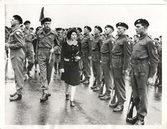 1944- Britain's Princess Elizabeth, who holds the rank of Colonel-In-Chief of the Grenadier Guards, inspects a guard of honor of her regiment.
