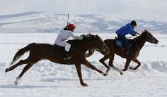 Riders compete on the frozen Yenisei River during the 45th Ice Derby amateur horse race near the settlement of Novosyolovo, south of the Siberian city of Krasnoyarsk, March 14, 2015.   The Ice Derby has been held in Novosyolovo annually at the end of each winter since 1969, drawing participants from the entire region.