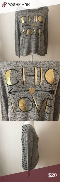 Large CHIC LOVE Arrow Heart Gray Gold LS Tee Shirt Women's Modern Lux Knit Shirt  CHIC LOVE  Size: Large  Measurements In Inches: Across the Chest: 18 Sleeves: 23 Length: 25  Good, clean pre-owned condition with no rips or stains!   Clothing measurements are taken in inches with the garment laying on a flat surface. Across the Chest is from under one arm to the other. Body Length is from the collar seam to the hem. Sleeve is from shoulder seam to the cuff; if no seam, measurement is from the…