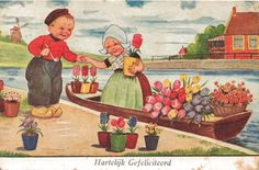 Postcard of Dutch Children with Flowers and Boat in a Canal from antique-ables on Ruby Lane