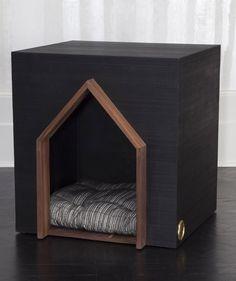 KELLY WEARSTLER | BEAU DOG HOUSE. Composed of ebonized ribbed walnut and adorned with burnished bronze insignia.