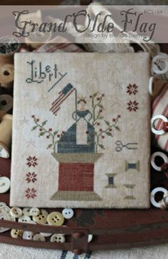 Grand Ole Flag is the title of this cross stitch pattern from With Thy Needle and Thread that features a patriotic design that is to honor Betsy Ross and I love that she is on top of a spool of thread.