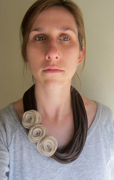 This mocha rose t-shirt scarf necklace is made from recycled jersey knit t-shirts and the felt roses are made by hand. The oatmeal color roses really look great against the chocolate brown shirt yarn. This necklaces could be worn dressy or casual and would make great gift!    Measures 18