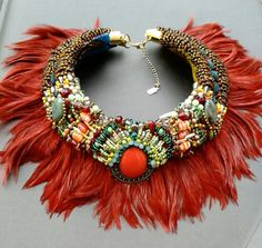 Afia feather collar from Anita Quansah London. Featuring reclaimed vintage pendant with intricate beadwork.