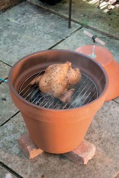 Make a smokin' smoker: Accessorize a clay pot with a grate, hot plate and lid with handle.