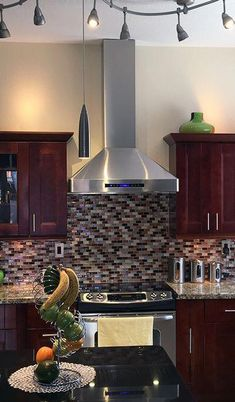 Beautiful Red toned Kitchen featuring the PLJW 130 Stainless Steel Wall Mount Range hood from Proline sent to us from one of our customers. View our Vent Hood Selection: prolinerangehoods. Kitchen Vent Hood, Warm Kitchen, New Kitchen, Kitchen Decor, Kitchen Range Hoods, Kitchen Stove, Kitchen Cabinets To Ceiling, Kitchen Backsplash, Backsplash Design
