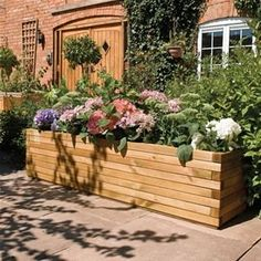 Sitting at 1.8m in length, this incredible Rowlinson Rectangular Wooden Patio Trough Planter is