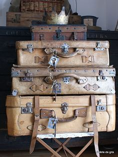 Rustic display of vintage suitcases. Beautiful arrangement for your wedding, shower, or any event you have in mind.