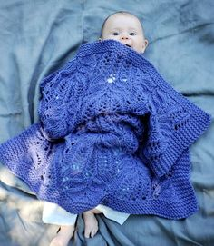 That stitch pattern is gorgeous, but lacey blankets are no good for babies, in my opinion - they're too holey and little fingers and toes get caught in them.
