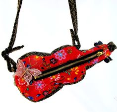 Cool Violin (Cello Music) Purse - un from Italy ordered an exquisite handmade violin mini purse. It had hand fired leaves for tuning pegs. And was lost in the mail!