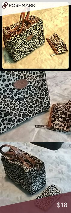"Lancome Set Leopard Print Faux Fur Makeup Bags Lancome very nice unused makeup bag set. Faux fur in a leopard print with tan faux leather trim. Includes large handled rectangular bag and small change purse type bag, both with zipper closures. Very spacious. 8"" x 6 1/2""  x 4 1/2""w and 5 1/2"" x 3"" Lancome Bags Cosmetic Bags & Cases"