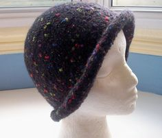 Hand knitted boiled wool felt hat black with by SpinningStreak