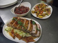 Main courses from the Valencienne sharing menu - Slow cooked belly of pork with crackling, savoy mash & cider cream sauce, fillet of red mullet with crushed new potatoes & sauce vierge, artichoke & red wine risotto with balsamic roasted cherry tomatoes, basil & parmesan