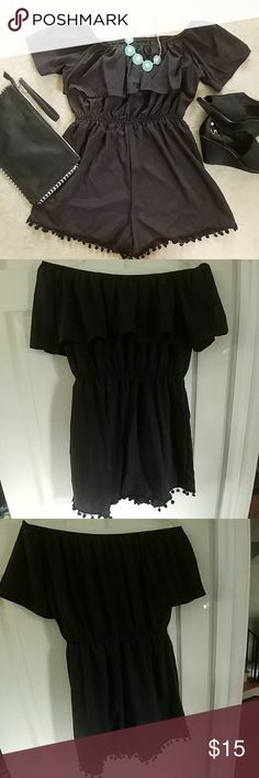 Cute Off the Shoulder Ruffled Romper NWOT Cute Off the Shoulder Ruffled Romper NWOT.  Ruffled detail across the front; elastic waist and shoulder; trendy pom pom trim on legs. Size Large fits true to size. Bust measures 19 inches; 3 inch inseam. 100% Polyester. Pants Jumpsuits & Rompers