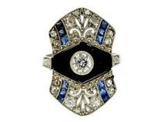 Art Deco Onyx, Sapphire & Diamond Ring. I find this one to be exceptionally beautiful.