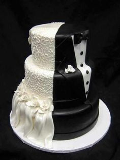 Bride and groom cake ... 1 halve brides dress and the other side grooms suit !