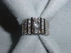 Ladies Diamond Channel Set Band. Combined customer's multiple stones into one custom piece.