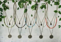 Welcome to Ananke Jewelry :) This is a handmade bohemian / hippie style layered (multi strand) necklace for woman. Antique brass chains & findings. The shortest necklace has a little leaf pendant, the medium layer is combined with beads and the longest one has a round mandala pendant. All the layers are connected to one clasp. If you wish to order this necklace as a set of three, so you can wear each separately, just note it at checkout :) ____________________________________________...