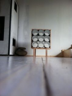 Upcycled design, steel pipe rack, newspaper rack, wine rack, Nanowo design