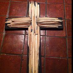 A cross made out of broken drumsticks.
