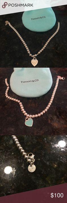 Tiffany & Co return to Tiffany 7in bracelet Tiffany & Co Return To Tiffany 7 inch bracelet with heart charm return to Tiffany on one side and Tiffany blue on the other side. Comes with original Tiffany jewelry bag. Tiffany & Co. Jewelry Bracelets