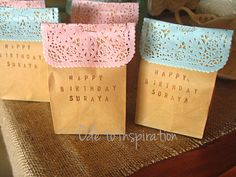 Doily and Brown Bag School Birthday Treats filled with chocolate covered pretzels and popcorn.