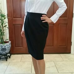 "NWOT Saks Fifth Avenue Wool Skirt NWOT 100% wool skirt. Waist 28.5"". Hip 39"". Length 24"". No trades. No low balling. Happy Poshing. Saks Fifth Avenue  Skirts Pencil"
