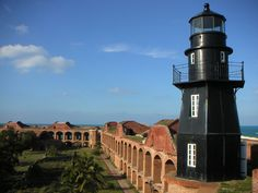 The Garden Key Light, also known as the Tortuga Harbor Light, is located at Fort Jefferson, on Garden Key in the Dry Tortugas, Florida, US.