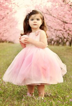 Cute little girl dressed in pink with pink blooming tree in the background. OH MY!! Wanna paint Tenley & Katie like this!!!!