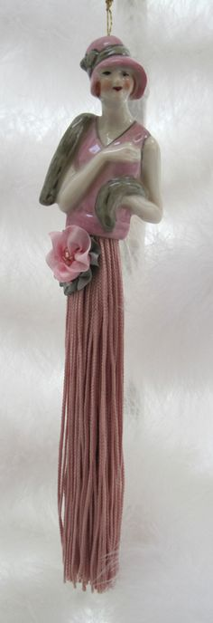 Victorian flapper tazzle doll.  This in no way is Victorian.  It's obviously art deco.
