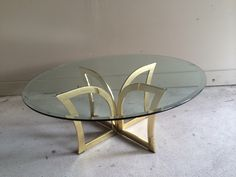 Hollywood Regency Mid Century Modern Sculptural Brass and Glass Coffee Table by HouseofVintageLovely on Etsy https://www.etsy.com/listing/245336012/hollywood-regency-mid-century-modern