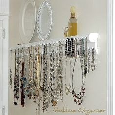 """Necklace/bracelet organizer shelf. I intended to hang this on a wall in my walk-in closet but thought it pretty enough to display in my dressing area with my necklaces right at my fingertips."""""""