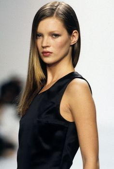 Kate Moss walking for Calvin Klein, 1994.