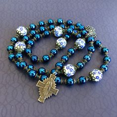 From my #etsy shop: https://etsy.me/2JhUYec    Seven Sorrows #Rosary, Blue, White & Bronze #Catholic #Servite #Devotion to Our Lady of Sorrows. #TLM #Church #Orthodox #Traditional #Pope #Saint #PopeLeoXIII #PadrePio #BlessedMother #JesusChrist #Hope #Faith #Love #Peace