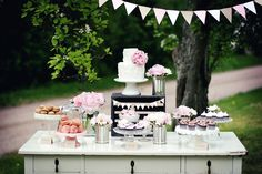 beautifully styled rustic dessert table...with different heights and simple decorations.