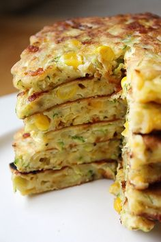 Zucchini Corn Pancakes -- crunchy sweet corn, soft, fresh zucchini and tangy sharp cheddar cheese. Making this summer with my garden squash and zucchini. Think Food, I Love Food, Good Food, Yummy Food, Vegetable Recipes, Vegetarian Recipes, Cooking Recipes, Healthy Recipes, Corn Recipes