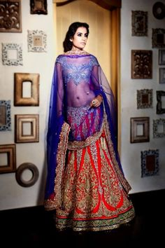 Indian bridal clothes. Indian wedding clothes. Red lehenga for a wedding.